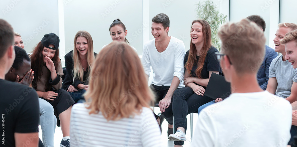Fototapeta close up. group of young people sitting in a circle.