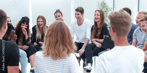 Fotomural close up. group of young people sitting in a circle.
