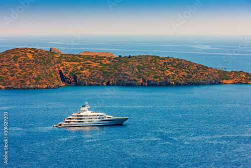 Large luxury white yacht off the coast of Crete, Greece. Obraz na płótnie