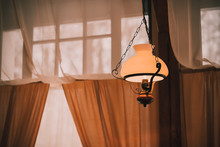 Vintage Kerosene Lamp ,chandelier With Large Lampshade.vintage Style. Retro Lampshade Hanging With Electric Lamps. Light In The Dark Hope Concept Idea. Vintage Technology.Old Decorative Lamp, Interior