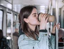 Young Woman Drinking Coffee On...