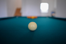 Cue Ball On Pool (billiard) Table With Other Balls In Distance