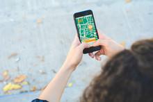 Woman Using GPS Map Navigation...