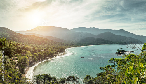 Castelhanos Beach aerial view through the heart belvedere of Ilhabela Island, one of the main landmarks of the coast of São Paulo, with natural tropical vegetation and paradise scenery in Brazil