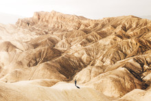 Man Standing In Desert