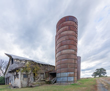 Abandoned Barn With Silo Under...