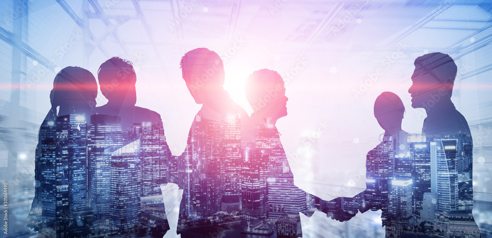 Fototapety, obrazy: Double exposure image of many business people conference group meeting on city office building in background showing partnership success of business deal. Concept of teamwork, trust and agreement.