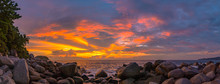 Panorama Sunset At Laem Sai Cape. Many Small And Large Stones Surround Laem Sai Cape From Karon Beach To Kata Beach..