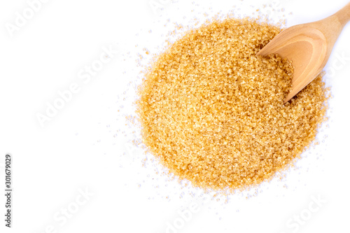 Fototapeta Closeup pile brown sugar isolated on white background .Top view.Flat lay. obraz