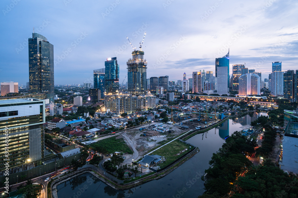 Fototapety, obrazy: Twilight over the Jakarta business district in Indonesia capital city