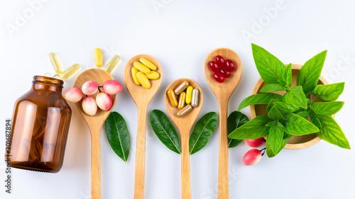 Alternative herbal medicine, vitamin and supplements from natural, pills and cap Fototapeta