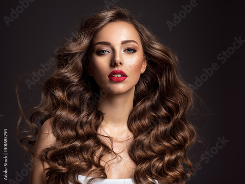 Fotografie, Obraz Beautiful woman with long brown hair and red lipstick.