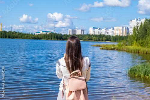 Valokuva  brunette girl with a backpack enjoys stunning scenic views