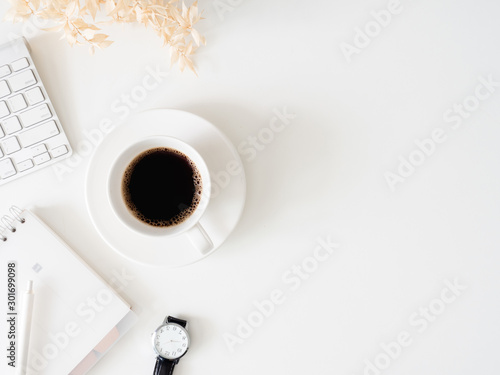 Obraz top view of office desk table with coffee cup, keyboard and notebook on white background, graphic designer, Creative Designer concept. - fototapety do salonu