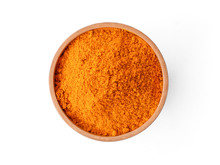 Closeup Turmeric ( Known As Curcumin, Curcuma Longa Linn) Powder In Wooden Bowl Isolated On White Background With Clipping Path.Top View. Flat Lay.