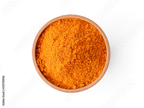 Fototapeta Closeup turmeric ( known as curcumin, Curcuma longa Linn) powder in wooden bowl isolated on white background with clipping path