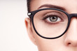 Female eye with long eyelashes in eyeglasses. Model in glasses. Vision correction. Poor eyesight. Spectacle frame. Makeup, cosmetics, beauty. Close up, macro