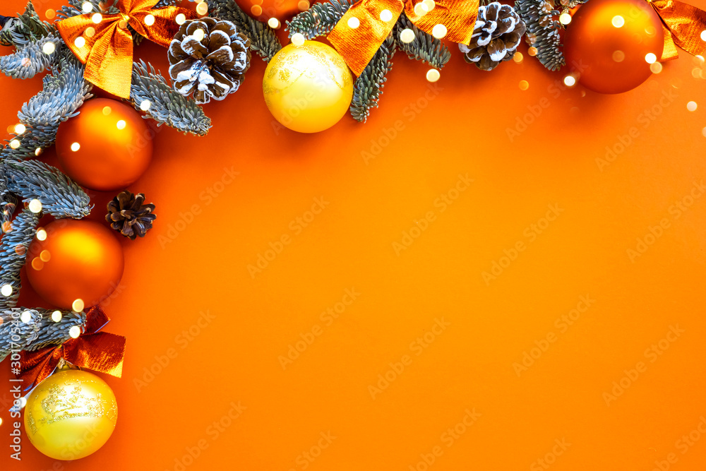 Fototapeta Christmas composition. Background orange colors with decorations. Christmas, winter, new year concept. Flat lay, top view, copy space .