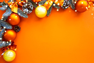 Christmas composition. Background orange colors with decorations. Christmas, winter, new year concept. Flat lay, top view, copy space .