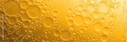 Biodiesel, bubbles biofuel, vegetable oil, yellow and orange emulsion bubbles background - 301708042