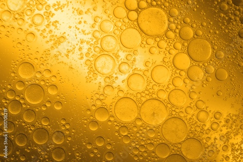 Biodiesel, bubbles biofuel, vegetable oil, yellow and orange emulsion bubbles background - 301708219