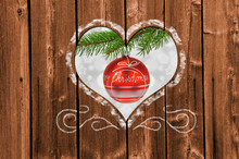 Looking Through A Carved Heart In A Wooden Wall To Christmas Decoration