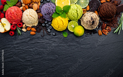Various of ice cream flavor ball blueberry ,lime ,pistachio ,almond ,orange ,chocolate and vanilla set up on dark stone background Wallpaper Mural