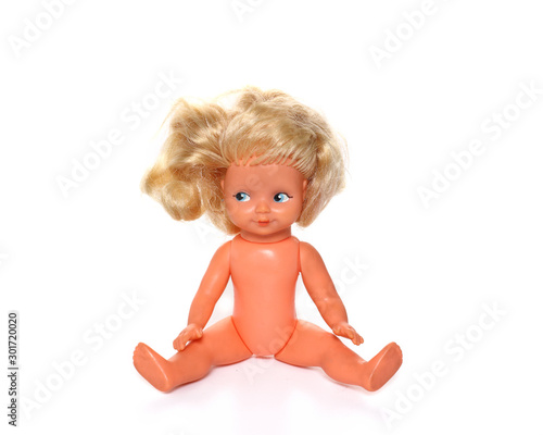 Photo Old baby doll with uncombed hair, toy isolated on a white background