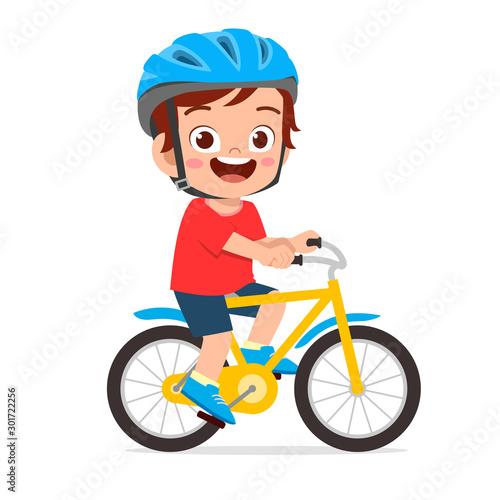 Fényképezés happy cute kid boy riding bike smile