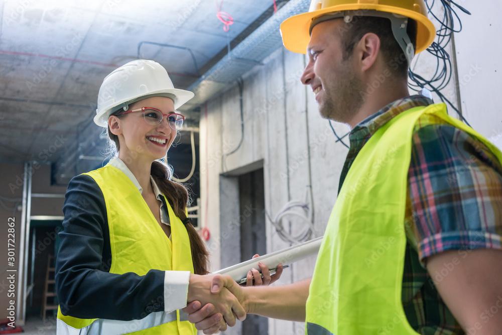 Fototapeta Handshake on the construction site