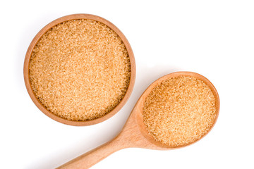 Closeup brown sugar in wooden bowl and spoon isolated on white background . Unhealthy diet ,awareness and stop diabetes concept. Top view. Flat lay.