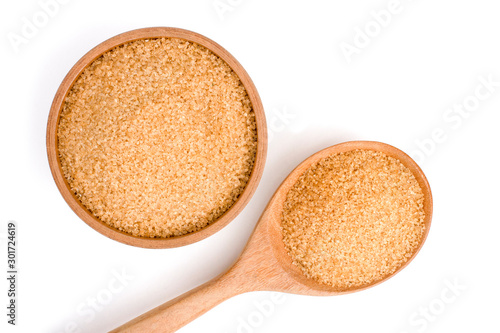 Fototapeta Closeup brown sugar in wooden bowl and spoon isolated on white background . Unhealthy diet ,awareness and stop diabetes concept. Top view. Flat lay. obraz