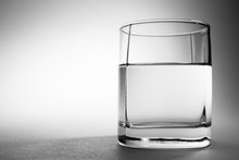 Glass Of Drinking Water On Gra...