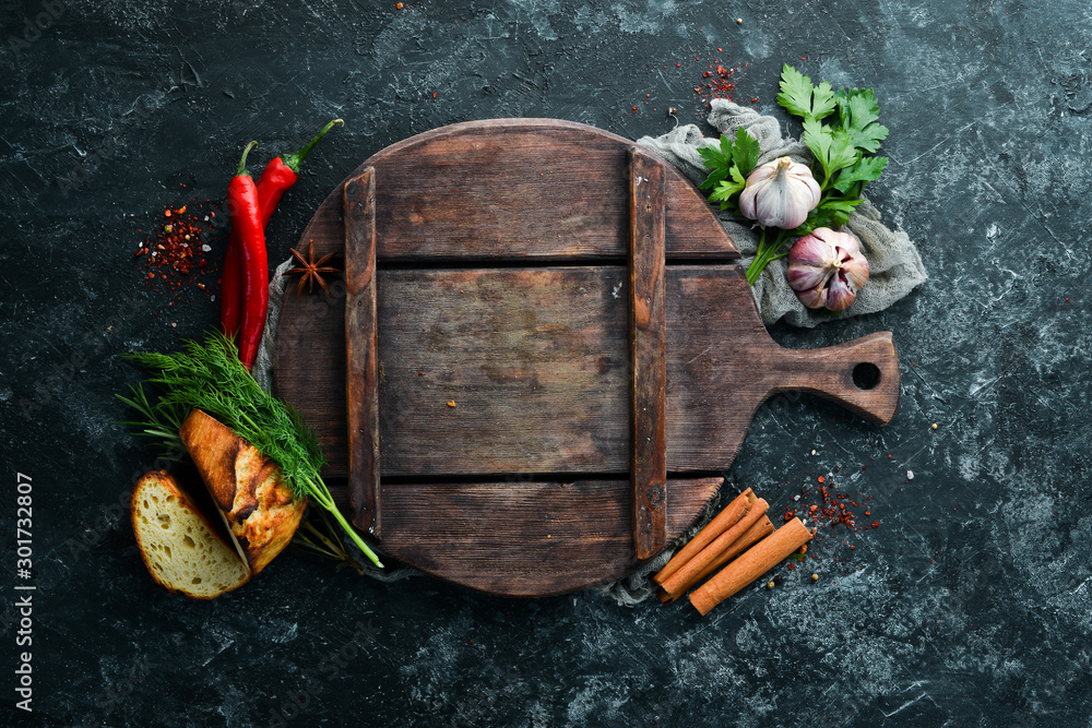 Fototapeta Background of cooking. Fresh vegetables and spices. Top view. Free copy space.
