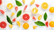 canvas print picture - Citrus fruits on white wooden background. Top view. Free copy space.