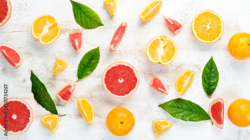 Tablou Canvas Citrus fruits on white wooden background