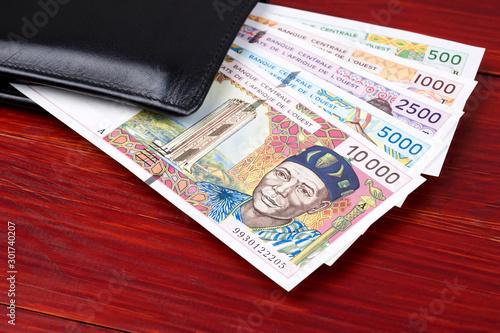 Obraz na plátně  Old West African States money in the black wallet