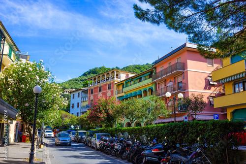 Foto auf AluDibond Südeuropa Sunny Cityscape of little street in Moneglia village in Liguria