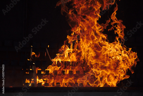 NB__8220 Fire flames with melting candles in Fatima