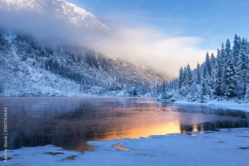 Fototapety, obrazy: Winter sunrise over scenic frozen lake