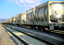 White Freight Train Wagons Having Oil Tankers Waiting On The Rails