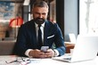 Business man in formal clothing using mobile phone. Serious businessman using smartphone at work