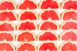 Leinwandbild Motiv Grapefruit red juicy slices background. top view.