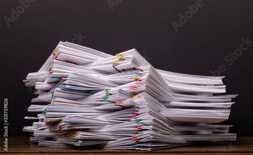 Fotografía  Stack overload document report paper.