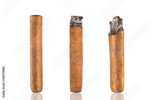Fotografie, Obraz  Set of cuban cigars, on a white isolated background.