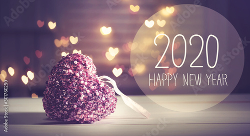 Fotografie, Obraz New Year 2020 message with a pink heart with heart shaped lights