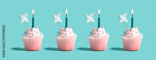 obraz PCV Tasty celebratory cupcakes with decorative lit candles