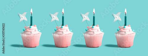 fototapeta na szkło Tasty celebratory cupcakes with decorative lit candles