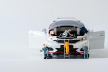 Miniature Fixing Car. Business Car Service Repair And Maintenance Concept