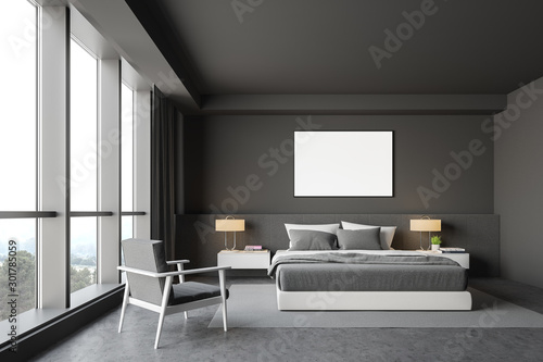 Gray master bedroom interior, armchair and poster
